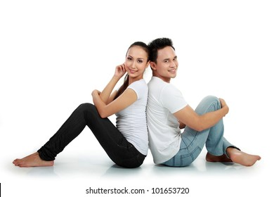 portrait of asian happy couple smiling while sitting on white background