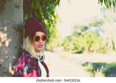 Portrait of asian hipster girl wear orange sunglass vintage style