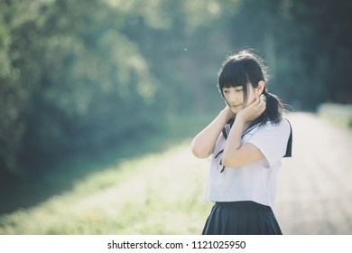 Portrait of asian japanese school girl costume looking at park outdoor film vintage style