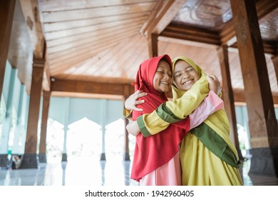 portrait asian kids girl Muslim laugh happiness and hug each other
