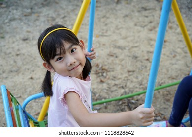 Portrait Asian kids little girl Playing the playground