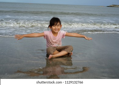 Portrait Asian kids little girl Playing on the beach