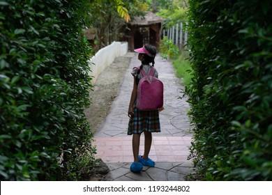 Portrait Asian kids little girl Backpack Walk in the park