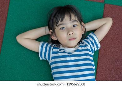 Portrait Asian kids little girl lie about