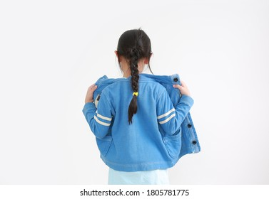 Portrait of asian little child girl wearing jacket shirt isolated on white background. Rear view.