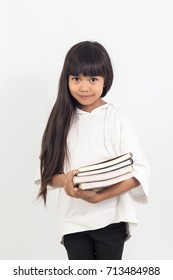 Portrait of asian little girl holding a book on white background