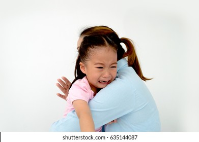 Portrait of asian little girl hugging her mother crying