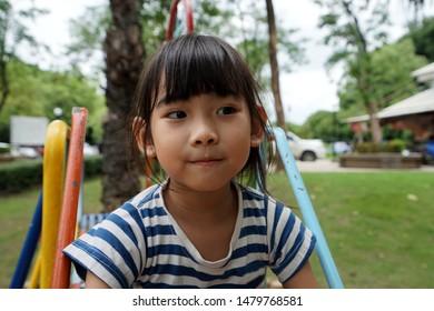 Portrait Asian little girl smiling happy
