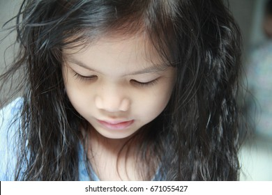 Portrait of Asian little girl,4 years old,Oppositional Defiant Disorder,Attention deficit/ hyperactivity disorder.ADHD. Gray back ground