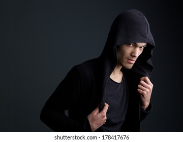 Portrait of an asian male fashion model on gray background