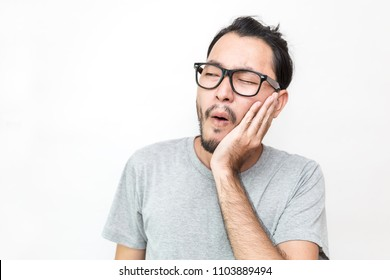 Portrait of asian male feeling painful toothache. Teeth problem man feeling tooth pain. Closeup of handsome sad man suffering from strong tooth pain. Dental healthcare stressful and medical concept.