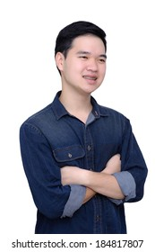 Portrait of asian man crossed arms and weared jeans shirt, close up shot on white background.