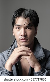 Portrait of Asian man in the jacket - Head shot