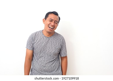 Portrait of Asian man with laugh face. Isolated on white background.
