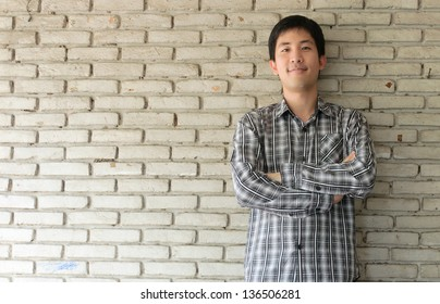 portrait of an asian man with old wall background