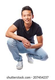 portrait of an asian man posing sitting