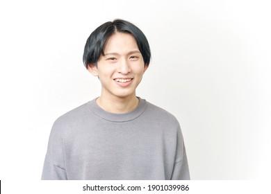 portrait of Asian man smiling on white