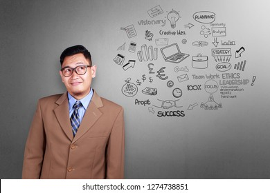 Portrait of Asian man smiling and thinking of business scheme, succesful businessman concept