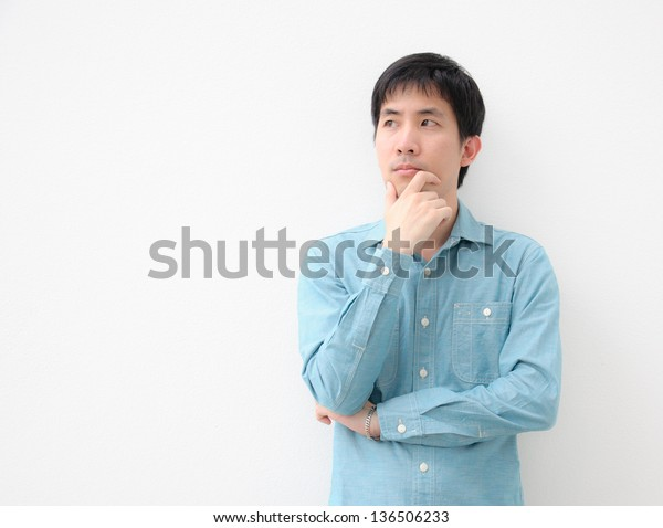 portrait of an asian man thinking