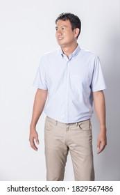 Portrait Asian man in wearing blue short sleeve shirt on white background.