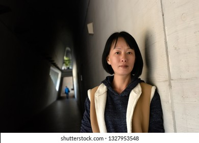 portrait of Asian mature beauty at the corridor