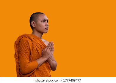 portrait asian monk, Novice are prayer, Buddhist are smile face, 			Asian monks, thai monk in a Buddhist temple, Time to concentrate, The monks to pray respect to the Buddha, Thailand religion,  prayer,