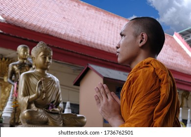 Portrait asian monk,Thai Novice are prayer, Buddhist are smile face, Indian monk, happy novices, thai monk in Buddhist temple,Time to concentrate,The monks to pray respect to the Buddha, Thai culture,