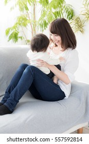 portrait of asian mother and baby relaxing