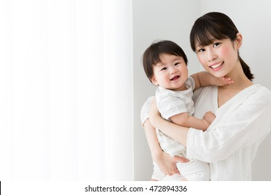 portrait of asian mother and baby in the room