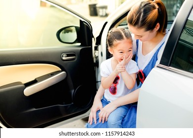 Portrait asian mother and daughter happy life in car and open the door