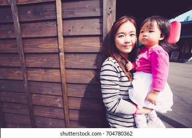 Portrait asian mother and daughter in Hokkaido Japan.
