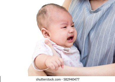 Portrait of an asian mother holding her crying cute little baby. Isolated on white background