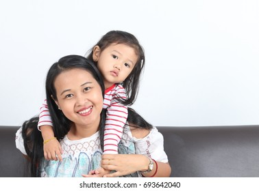 Portrait of Asian Mother and Asian kid, isolated on white background