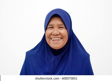 Portrait of Asian muslim woman/mother/grandmother isolated on the white background