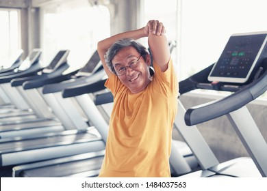 Portrait asian old man working out or exercise in fitness or gym center, Strength sporty and good healthy concept