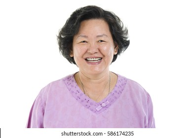 Portrait of Asian senior adult woman smiling, isolated on white background.
