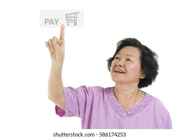Portrait of Asian senior adult woman online shopping and finger pushing at check out pay button, isolated on white background.