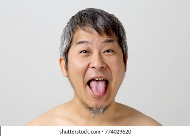 The portrait of asian senior man on the white background.