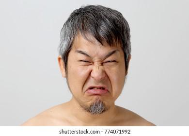 The portrait of asian senior man on the white background.