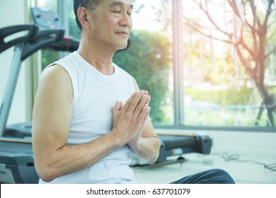 Portrait of asian senior sport man playing yoga at the gym. Close up elderly  man meditation, health care and medical concept