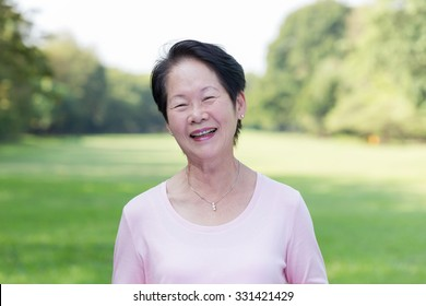 Portrait of Asian senior woman in the park