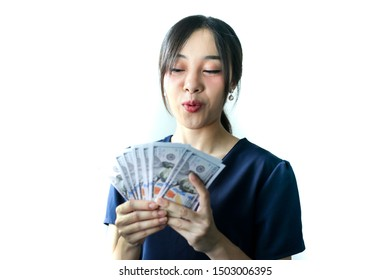 Portrait Asian smiling woman with dollars in hand,happy to have money concept.