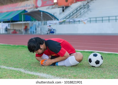 Portrait of asian soccer player warm up before big match in the field,Thailand people