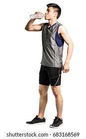 Portrait of an asian sport man wearing sportwear and drinking water. Isolated full length on white background with copy space