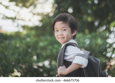 Portrait of Asian student with backpack outdoors,back to school concept