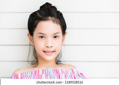 eb64c671f6f3 Portrait Asian teenage girl 11-12 year old wearing stylish clothes on white  wall background