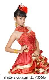 portrait of asian teenage girl dressing glamorous red gold on white background
