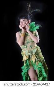 portrait of asian teenage girl dressing up in green kebaya modification on black background