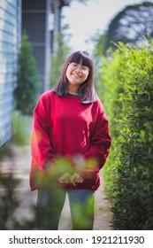portrait of asian teenager wearing eyeglasses standing outdoor