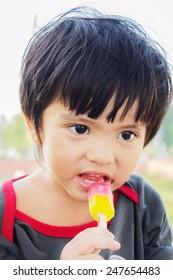 Portrait of Asian Thai little boy eating ice cream